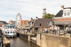 Tour boat by the old lock in Lemmer in Friesland in the north of Netherlands. Royalty Free Stock Image