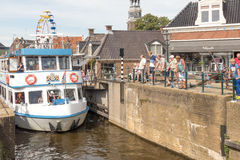 Tour boat by the old lock in Lemmer in Friesland in the north of Netherlands. Royalty Free Stock Images