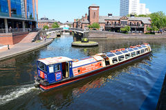 Tour boat at Old Turn Junction, Birmingham. View of The Malt House pub at Old Turn Junction with a tour boat in the foreground, Birmingham, England, UK, Western Royalty Free Stock Image