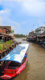 Tour boat parks in canal at Ampawa Thailand Royalty Free Stock Photo