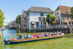 Tour boat with people in Alkmaar, Netherlands Royalty Free Stock Photo