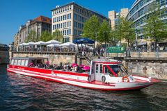 Tour boat at the pier on River Spree. Berlin Germany - April 20. 2018: tour boat at the pier on River Spree stock images