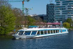 Tour boat on river Spree. Berlin Germany - April 20. 2018: Tour boat on river Spree stock photos
