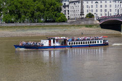 Tour Boat on the River Thames Royalty Free Stock Photo