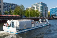 Tour boat sailing on river Spree. Berlin Germany - April 20. 2018: tour boat sailing on river Spree stock images
