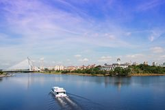 Tour boat sails. On the Putrajaya Lake Royalty Free Stock Photography