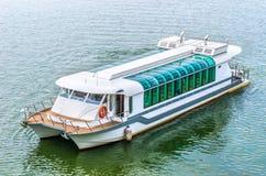Tour boat sails. On the Putrajaya Lake Stock Photography