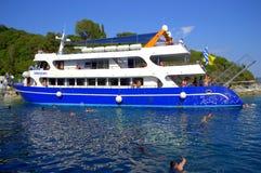 Tour boat on Scorpios beach Stock Photo