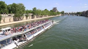 Tour boat on the Seine river in Paris, France stock video footage