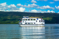 Tour boat on a sunny day at Loch Lomond lake in Luss, Scotland, 21 July, 2016 Stock Photo