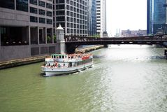 Tour boat. Touring the Chicago river stock photography