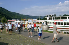 Tour boat and tourists on River Moselle, Germany. Germany, federal state Rhineland-Palatinate, town Bernkastel-Kues: in this tourist city, wine town at the Mosel Royalty Free Stock Photos