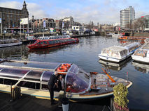 Tour boats in Amsterdam canal, Holland Stock Images