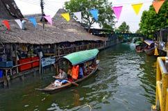 Khlong Lat Mayom floating market in Bangkok. Tour boats on the canal at Khlong Lat Mayom floating market in Bangkok, Thailand Stock Image