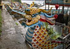 Tour boats with dragon heads, Hue Vietnam. Pictured are tour boats with dragon heads on the Perfume River in Hue, Vietnam. In Buddhism the dragon is the symbol royalty free stock images