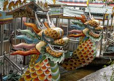 Tour boats with dragon heads, Hue Vietnam. Pictured are tour boats with dragon heads on the Perfume River in Hue, Vietnam. In Buddhism the dragon is the symbol stock photography