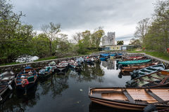 Tour boats in front of Ross castle in Killarney Royalty Free Stock Photo