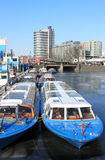 Tour boats in frozen canal, Amsterdam Royalty Free Stock Photo
