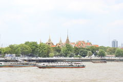 Tour boats moored in front of the temple. bangkok thailand Royalty Free Stock Image