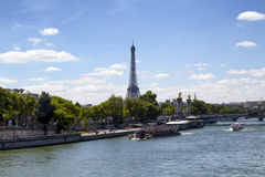 Tour boats are on Seine River in Paris. stock photo