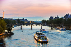 Tour Boats on Seine at Sunset. Lighted Tour Boats on Seine at Sunset Stock Images