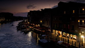 Tour boats traveling on grand canal near rialto bridge venice veneto stock video footage