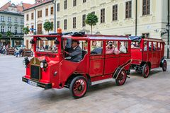 A tour in Bratislava, Slovakia. A tourist tour in Staré Mesto, Old Town, with a special converted old car train Stock Photo