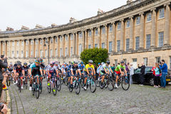 Tour of Britain in Bath, UK. BATH, UNITED KINGDOM - SEPTEMBER 12, 2014 : Michal Kwiatkowski, in the race leader's yellow jersey, leads the peloton around the Royalty Free Stock Image