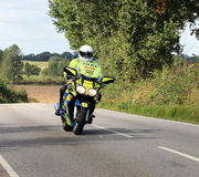 Tour of britain cycle race. Motorcycle police outrider Stock Photo