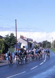 Tour of Britain cycle race stage 4 main peleton. With about 25 km to go the main peleton of the Tour of Britain cycle race passes through Pilling in Lancashire Royalty Free Stock Photos