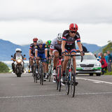 2016 Tour of Britain. Cyclists on Stage 2 of the Tour of Britain reach the summit of Chestnut Hill outside Keswick, Cumbria.  The race is a free public-event Royalty Free Stock Images