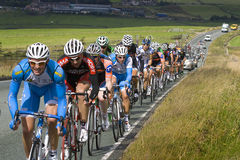 Tour of Britain Stage 2 Peloton. Tour of Britain Stage 2 - Peleton Riders in the Peak District on the A53 between Longnor and Leek, between KOM2 (Hollinsclough Stock Image