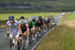 Tour of Britain Stage 2 Peloton. Tour of Britain Stage 2 - Peleton Riders in the Peak District on the A53 between Longnor and Leek, between KOM2 (Hollinsclough Stock Photo