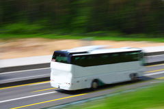 Tour bus. Goes fast on a highway Stock Image