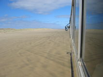On A Tour Bus. A tour bus travels along a wide flat beach near Cape Reinga, New Zealand Stock Images