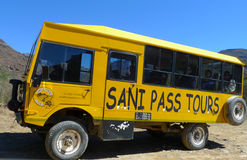 Tour bus climbing at Sani Pass trail between South Africa and Lesotho Stock Image