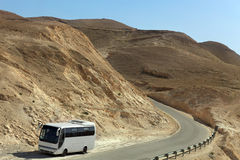 Tour Bus on Deserted road Royalty Free Stock Images