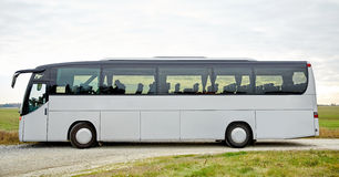 Tour bus driving outdoors Royalty Free Stock Photo