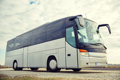 Tour bus driving outdoors Stock Image