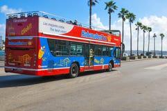 Tour bus in Havana. Havana, Cuba - December 19, 2016: Tourists sightseeing from tour bus on Malecon Avenue in Havana, Cuba Royalty Free Stock Photo