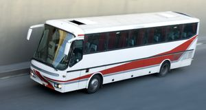 Tour bus isolated rides. A   tour bus isolated rides Royalty Free Stock Photography