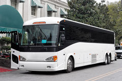 Tour Bus. Parked tour bus next to hotel entrance canopy Royalty Free Stock Photos