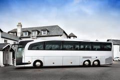 Tour bus parked Stock Photos
