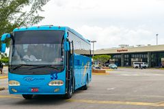 Tour Bus at the Sangster International Airport in Montego Bay, Jamaica royalty free stock images