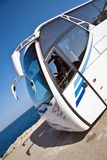 Tour bus at seaside. Tour bus front with seaside setting Stock Image