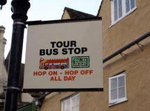 Tour Bus Stop sign. Hop on-hop off all day sign Royalty Free Stock Photos