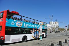 The tour bus on the streets  in Barcelona. Royalty Free Stock Images