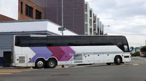 Tour Bus. In urban intersection Stock Image