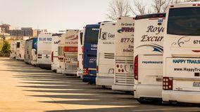 Tour Buses parked in parking lot. Tour buses parked in Arlington National Cemetary parking lot Stock Photos