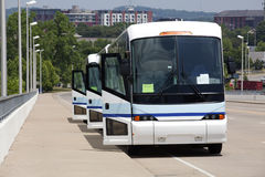 Tour Busses. Line of tour busses with their doors open Stock Photos